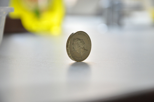 One pound coin on its side