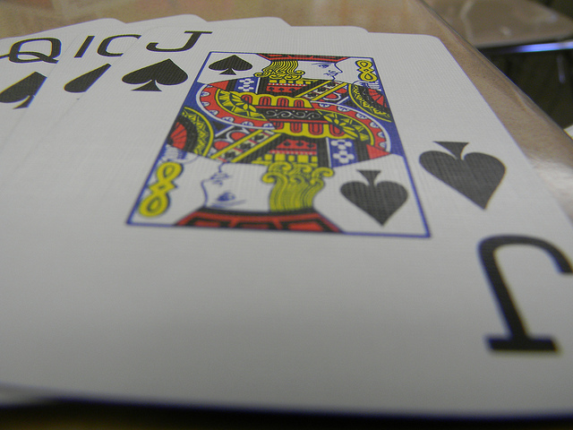 Jack of Spades card on top of other cards