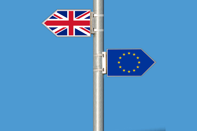 EU and British flag on pole
