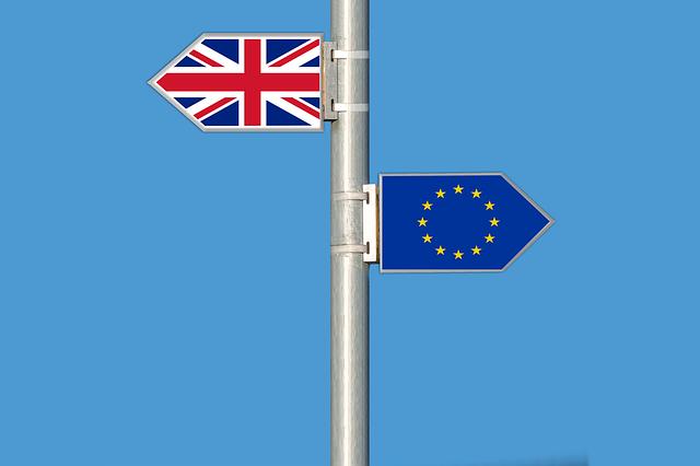 EU and British flag on pole